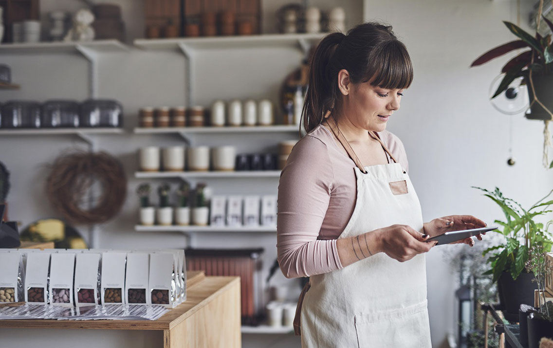 Business woman working with tablet in her shop