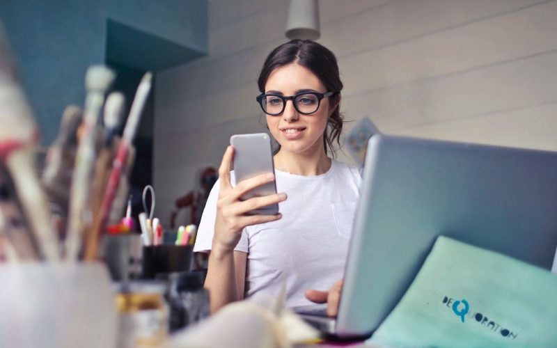 Young woman engaging mobile device